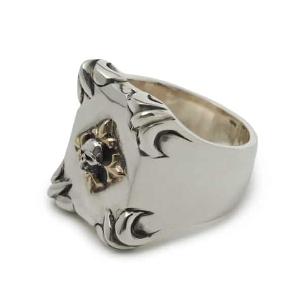 shield-with-skull-and-gold-fleur-de-lis-ring-angled