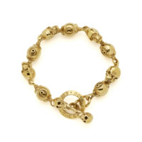 gold-skull-and-8ball-bracelet-above